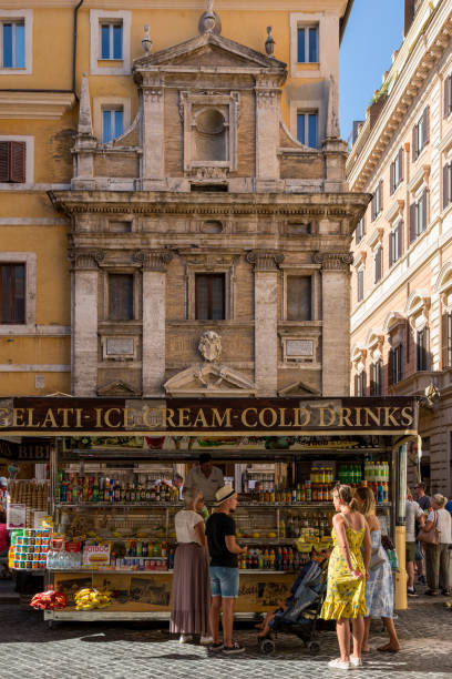 people in rome buy drinks and ice cream. - rome road central view foto e immagini stock