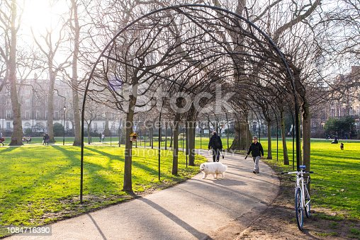 istock Russell Square, London, UK - February 2017. People in Russell Square, a large garden square in Bloomsbury, in the London Borough of Camden 1084716390