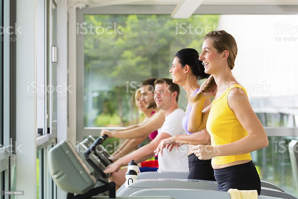 People in sport gym on treadmill running royalty-free stock photo