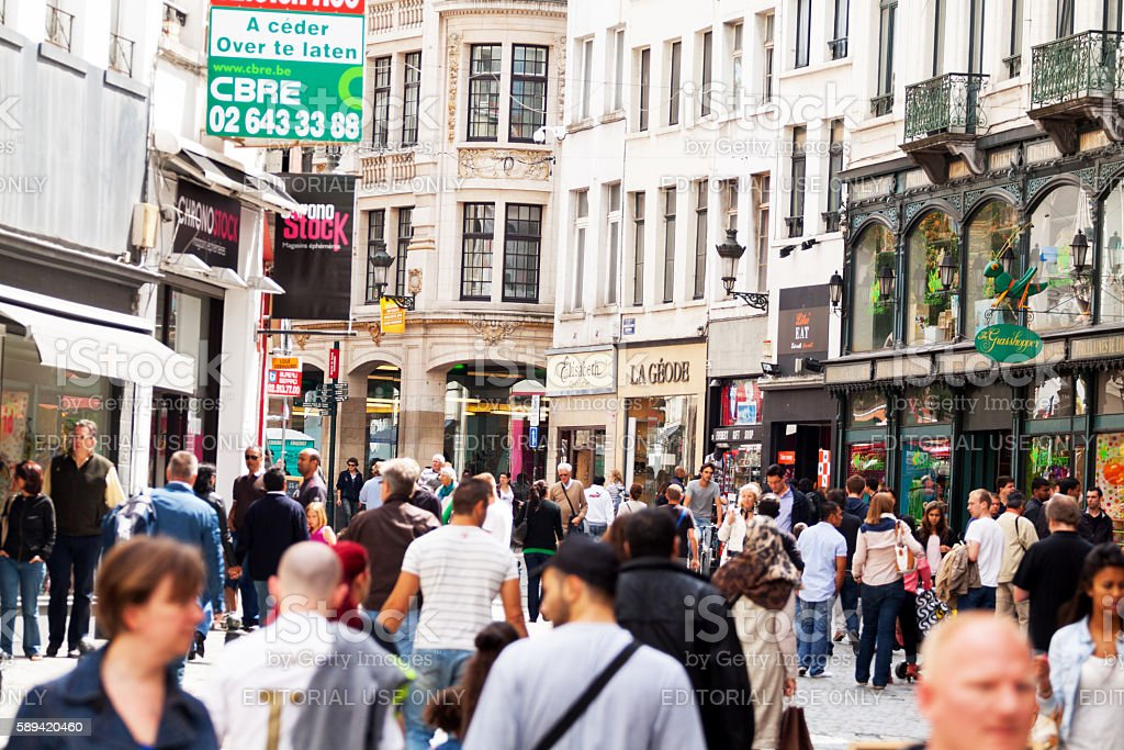 People in street Rue Marché aus Herbes in summer – Foto