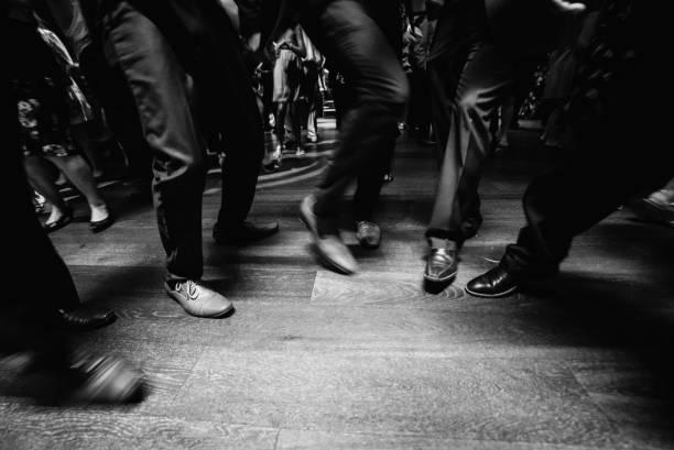 people in suit dancing on dance floor - dance floor stock photos and pictures