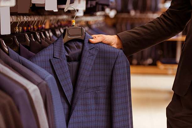 people in suit shop - menswear stock photos and pictures