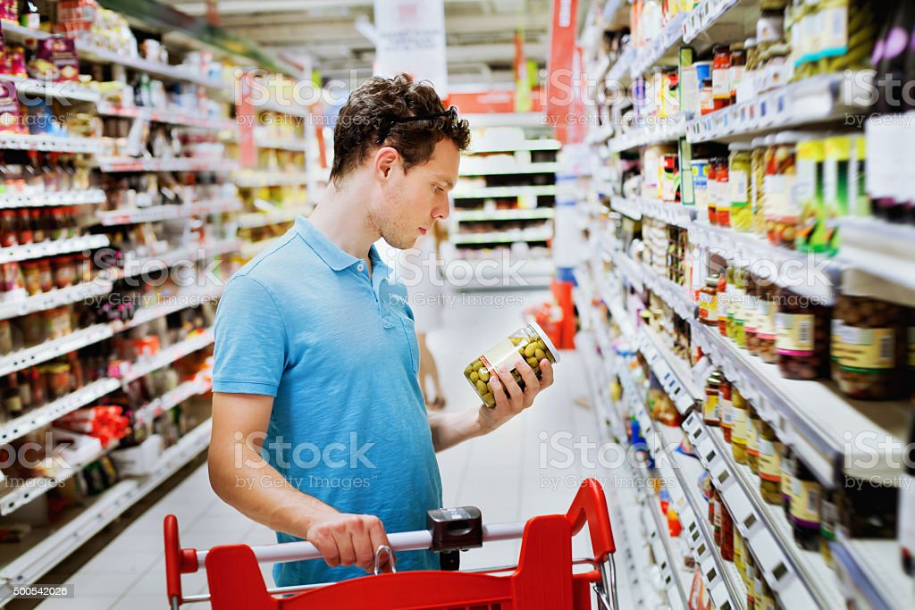 people in supermarket choosing food stock photo