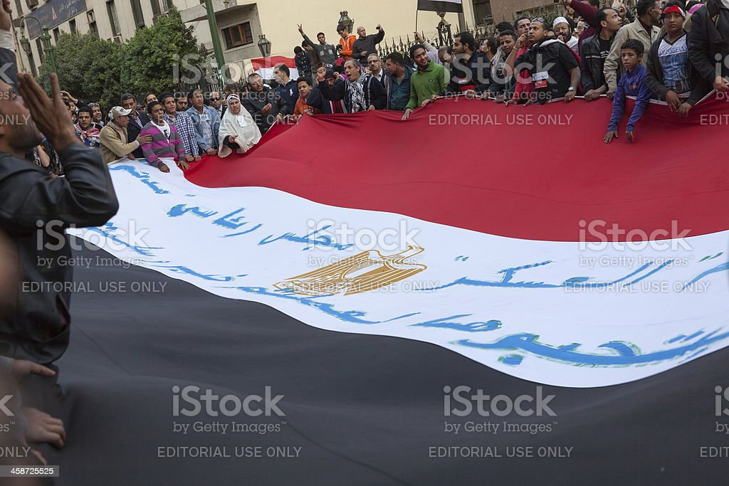 People in Tahrir Carrying a huge flag stock photo