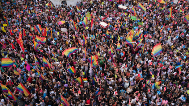 People in Taksim Square for LGBT pride parade in Istanbul, Turkey. Istanbul, Turkey - June 2013: People in Taksim Square for LGBT pride parade in Istanbul, Turkey. Almost 100.000 people attracted to pride parade and the biggest pride ever held in Turkey. lgbtqi pride event stock pictures, royalty-free photos & images