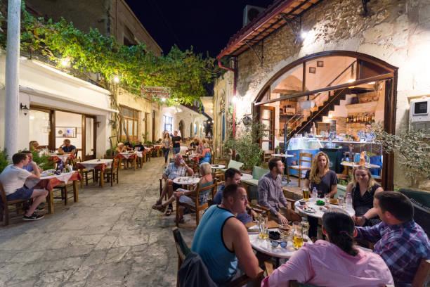 People in Taverna in village Panormos, Crete island - Greece stock photo
