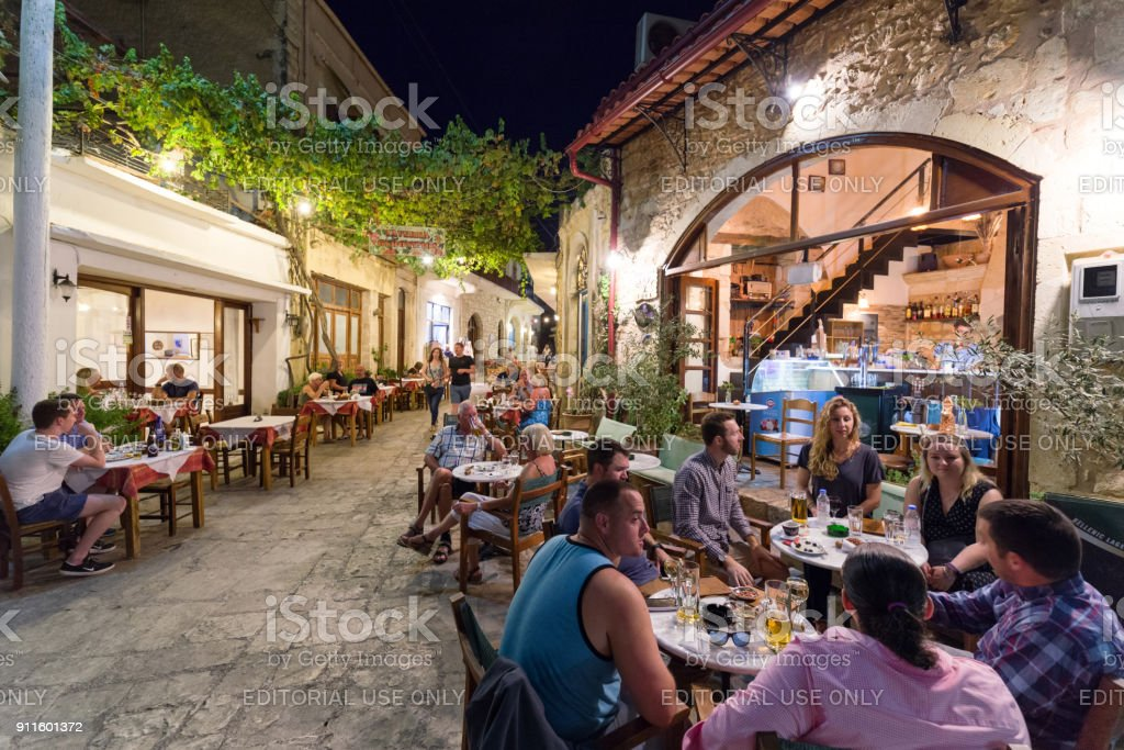 People in Taverna in village Panormos, Crete island - Greece stock photo