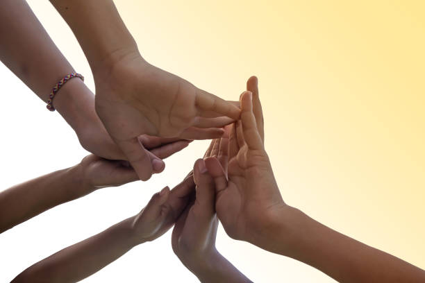 People in team harmonious hand meeting with worm light - foto stock