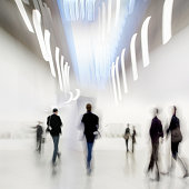 abstakt image of people in the lobby of a modern art center with a blurred background