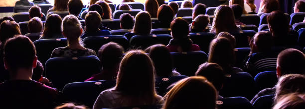 People in the auditorium watching the performance stock photo