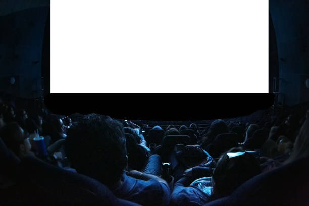 people in the cinema watching a movie. blank empty white screen. leisure entertainment concept. - stage performance space stock pictures, royalty-free photos & images
