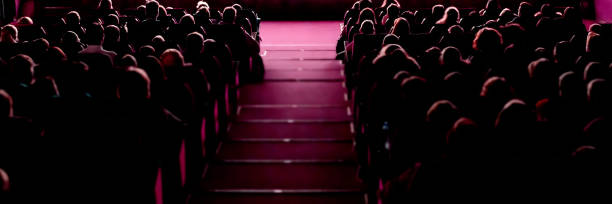 People in the cinema watching movie. People in the cinema auditorium watching movie performance theatrical performance stock pictures, royalty-free photos & images