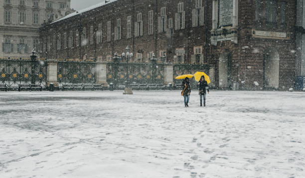 People in the city street under the snow stock photo