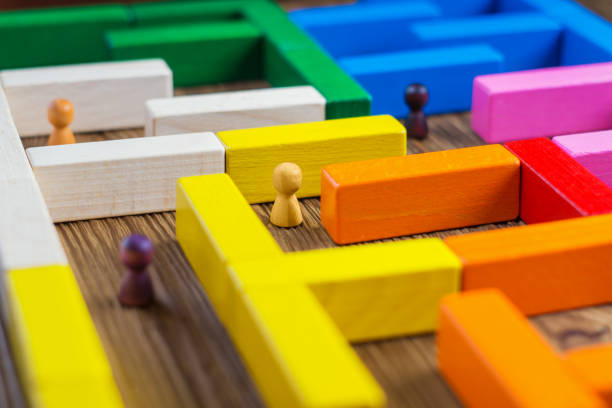 people in the maze, finding a way out. the man in the maze. the concept of a business strategy, analytics, search for solutions, the search output. labyrinth of colorful wooden blocks, tetris. - maze stock photos and pictures