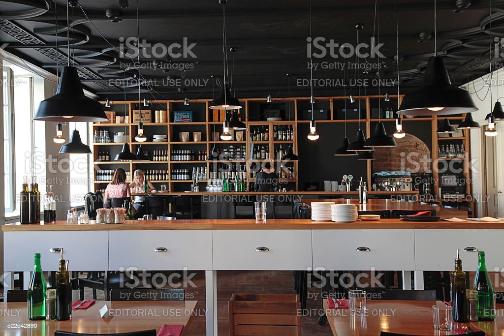 People in the modern cafe with cozy interior stock photo