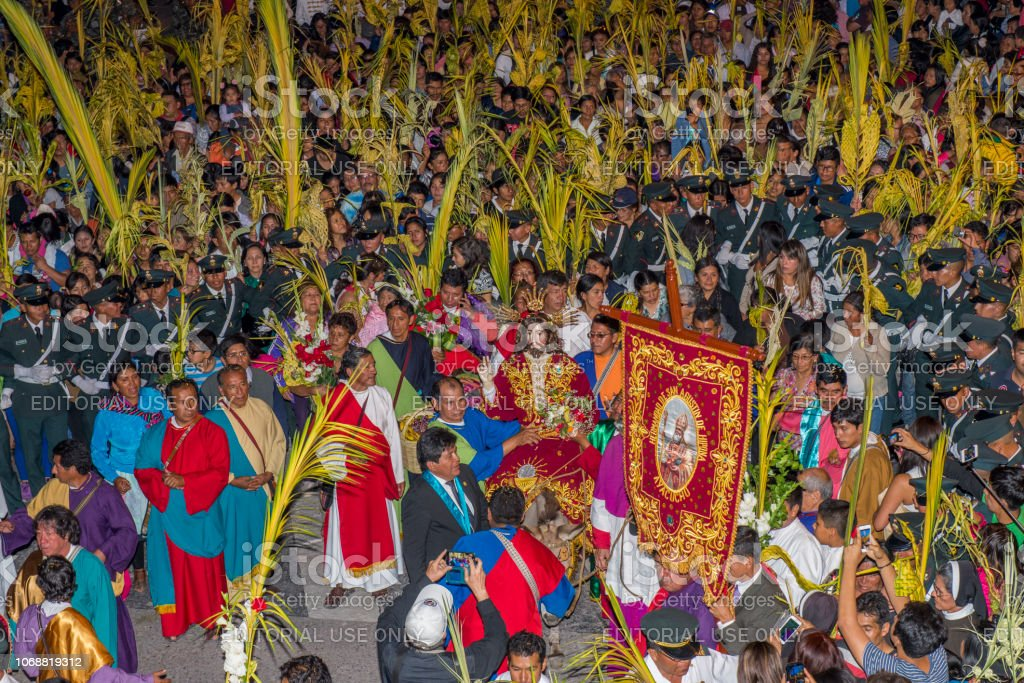 People in the night procession during the celebration of the Palm Sunday of Easter at Ayacucho city, Peru. stock photo