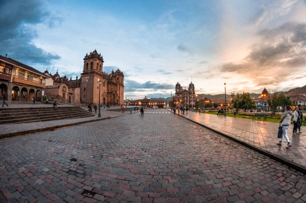 People In The Plaza Mayor Del Cusco At Sunset stock photo
