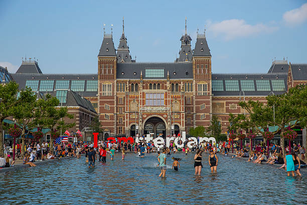 People in the pool in front of Rijksmuseum in Amsterdam stock photo