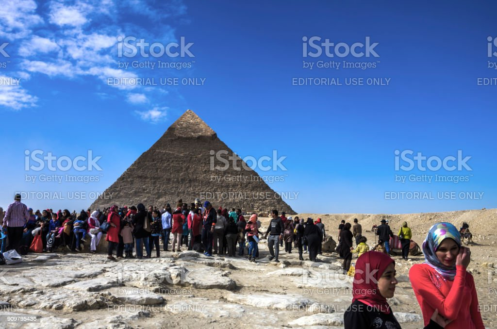 People in the Pyramids of Giza. Cairo, Egypt. stock photo