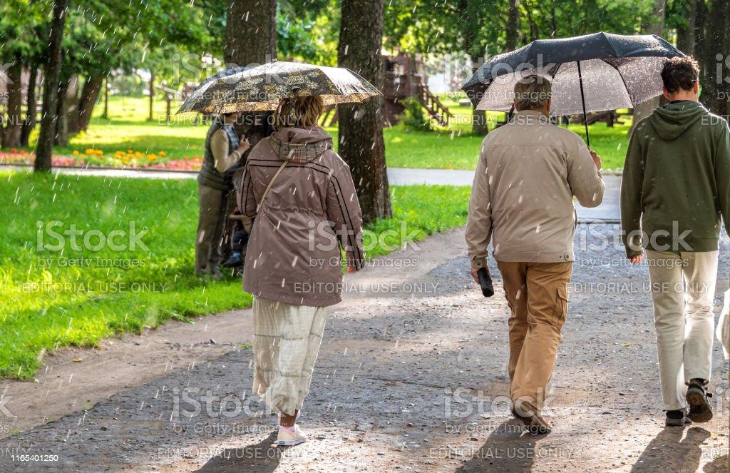 Uglich, Russia - July 30, 2019. People in the rain.