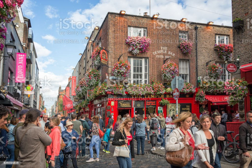 People in the street in front of the famous Temple Bar, in Dublin, Ireland stock photo