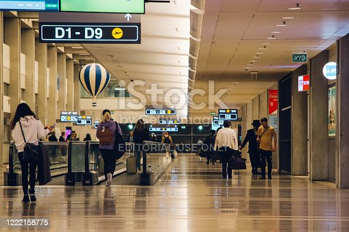 People walk inside the terminal at Ben Gurion Airport