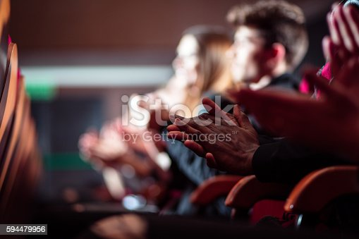 istock People in the theater, close up of clapping hands 594479956