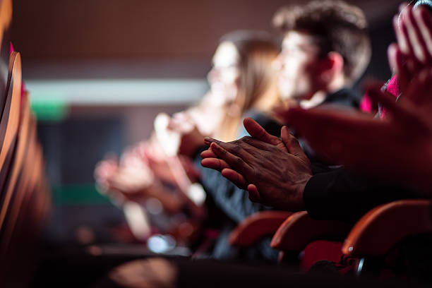 People in the theater, close up of clapping hands - foto stock
