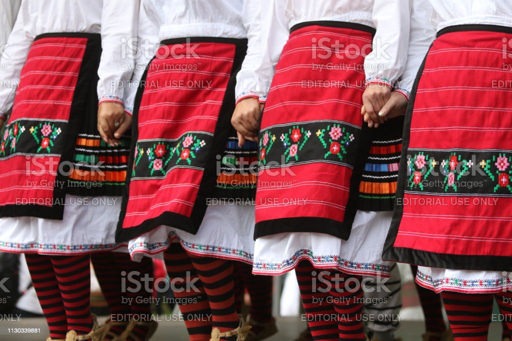 People in traditional authentic folk costumes, recreating the...