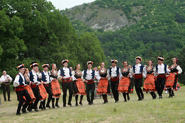people in traditional costumes dance bulgarian horo - ブルガリア文化 ストックフォトと画像