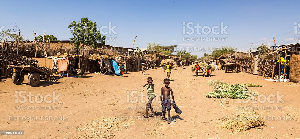 People in traditional village of Dassanech tribe. Omorato, Ethiopia stock photo