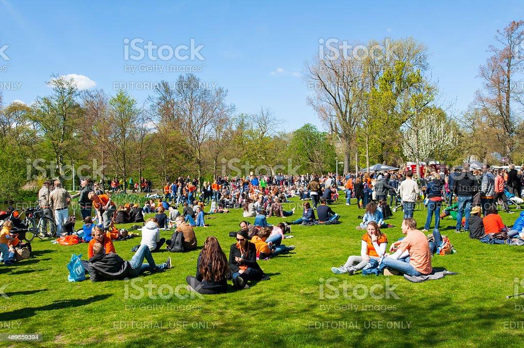 People  in Vondelpark celebrate King's Day, the Netherlands. stock photo