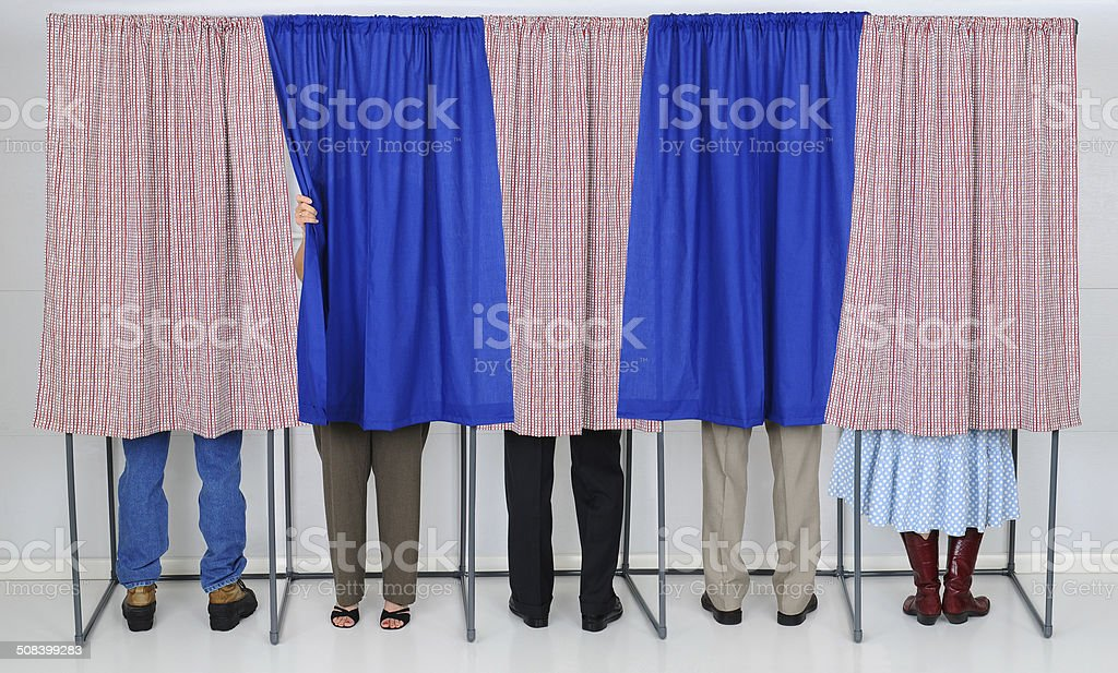 People in Voting Booths stock photo