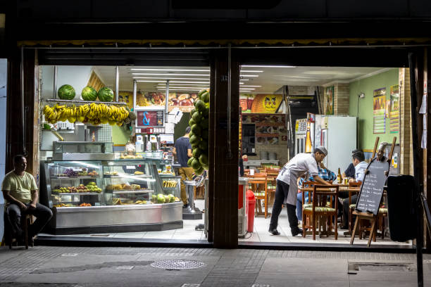 People inside of bar and restaurant in downtown São Paulo at night stock photo