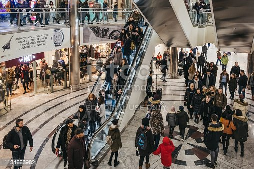 London, UK - January 26, 2019: People inside One Canada Square Mall in Canary Wharf, a busy financial area of London that often host events.