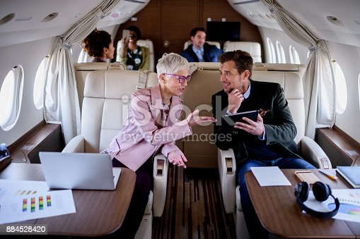 istock People inside private airplane 884528420