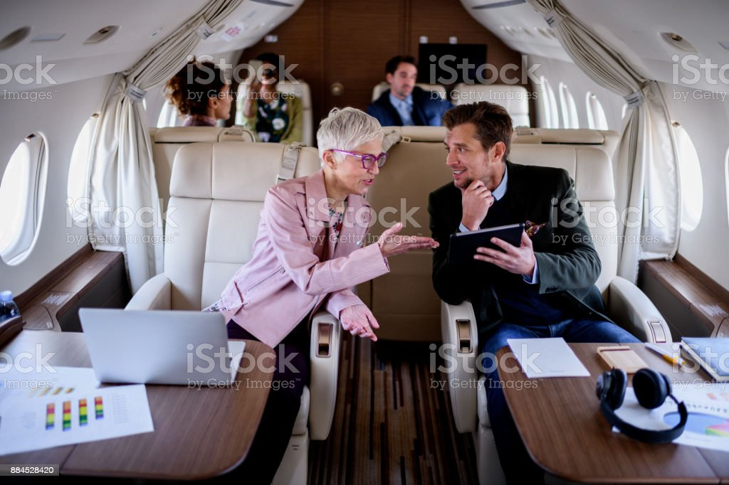 People inside private airplane stock photo