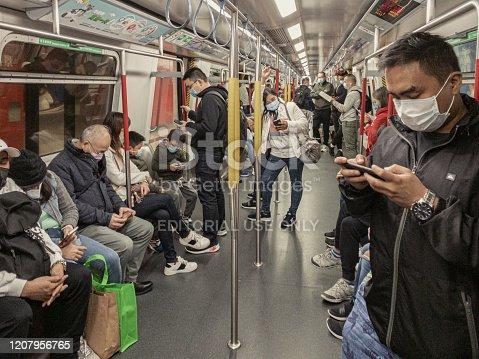 Hong Kong, China January 27th 2020 : People inside subway cover their faces with masks during the Coronavirus Covid19 health crisis in Hong Kong