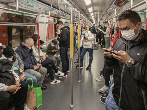 People inside subway cover their faces with masks during the Coronavirus Covid19 health crisis in Hong Kong stock photo