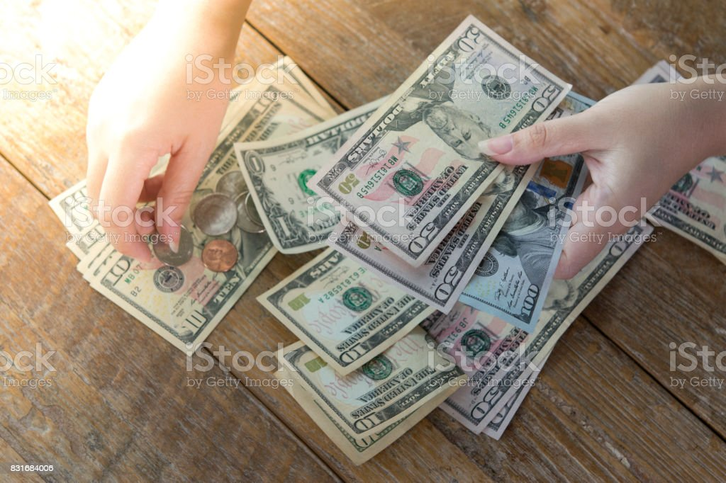 People is counting money. stock photo