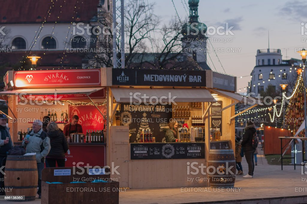 People is shopping mulled wine at Christmas market stock photo