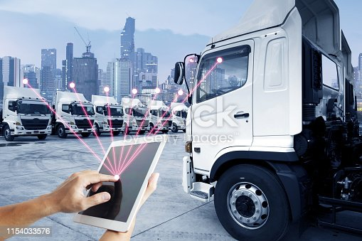 People is using tablet to control trucking transportaion service as technology concept.