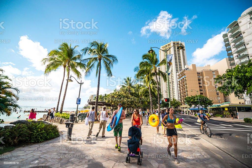 People jogging, cycling and walking, Waikiki Beach stock photo