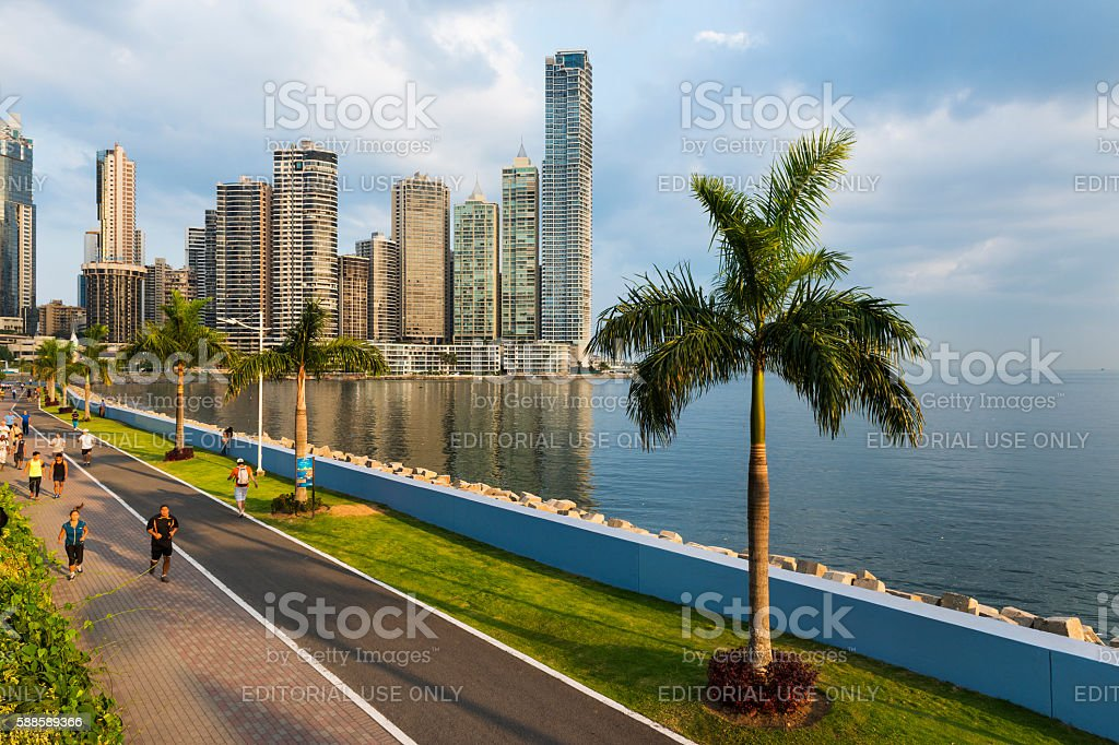 People jogging in a sidewalk in Panama City stock photo