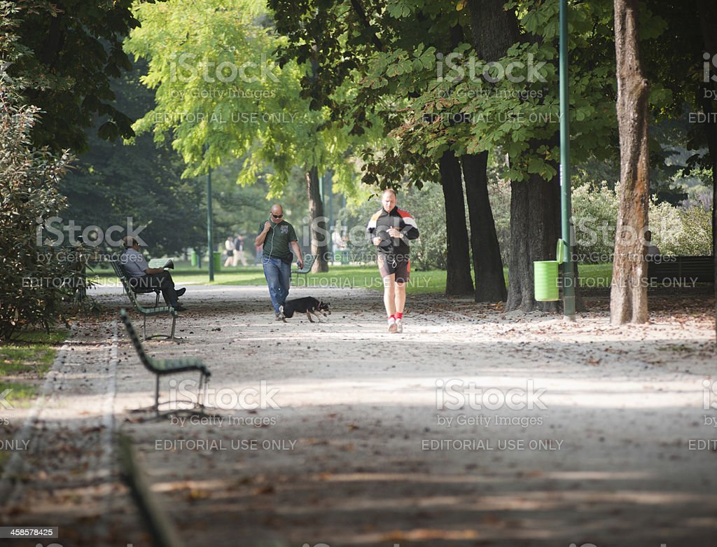 People jogging in Park Sempione - Milan, Italy stock photo