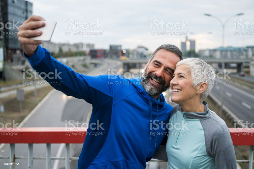 People jogging outdoors stock photo