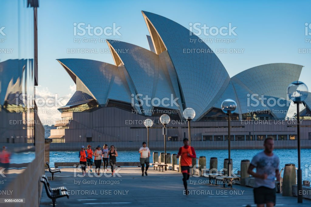 People jogging with Sydney Opera House on the background stock photo