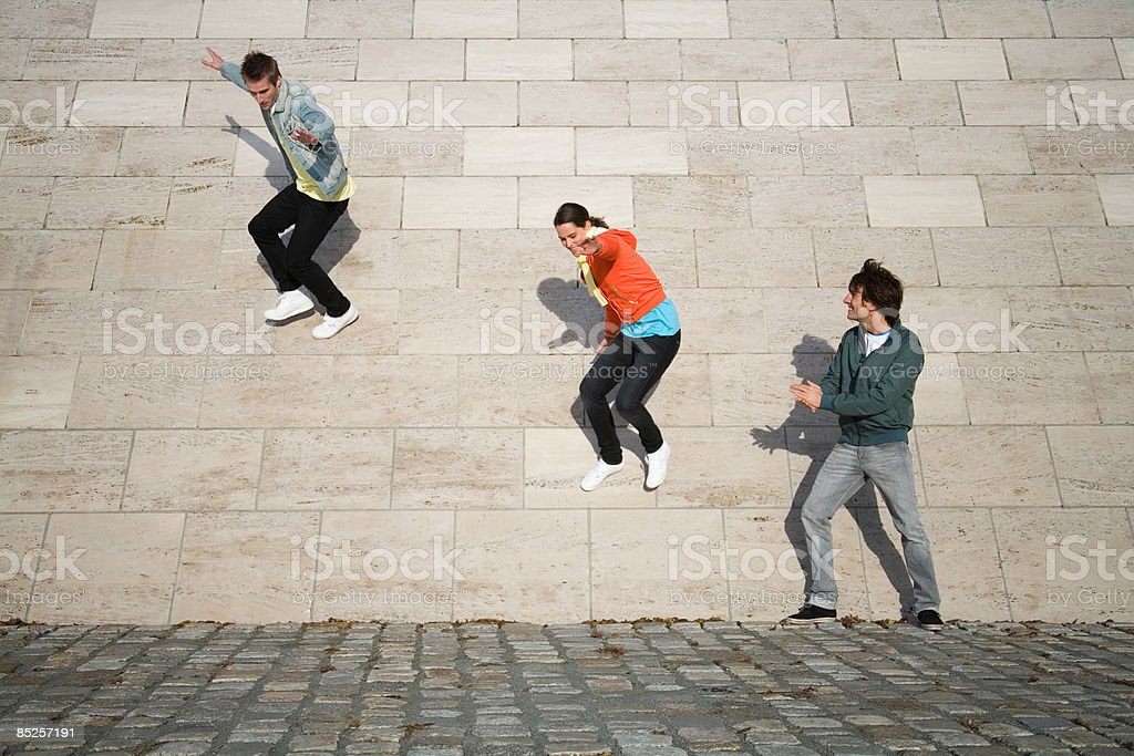 People jumping off wall royalty-free stock photo