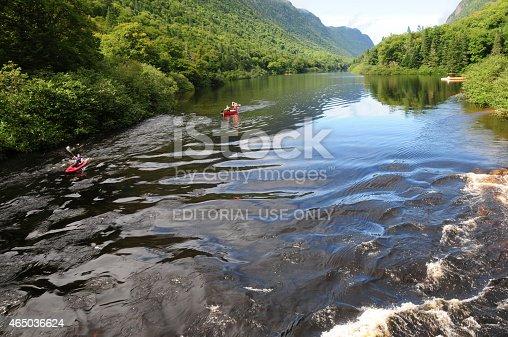 Quebec, Canada - September 6, 2014: Two kayaks flowing downriver in Grands-Jardins National Park, Quebec, Canada