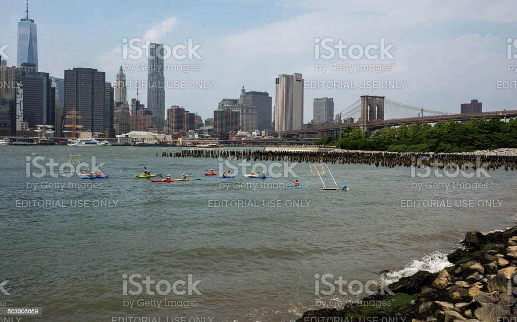 People kayaking in the east river in New York City stock photo
